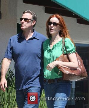 Marcia Cross and husband Tom Mahoney shopping at Malibu Mall