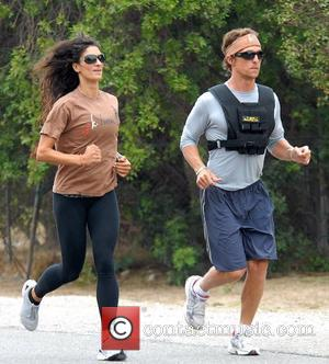 Matthew McConaughey wearing a V-Max weight vest whilst jogging with his personal trainer in Malibu Los Angeles, California - 01.08.08
