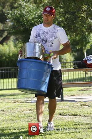 Mark Wilkerson spends the afternoon in Beverly Hills Park with his wife Melissa Joan Hart and their son Los Angeles,...