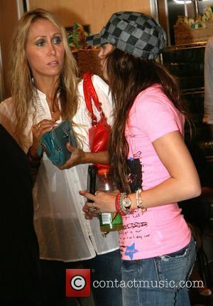 Tish Cyrus and Miley Cyrus stopping for lunch at Cafe Metro in Manhattan New York City, USA - 04.09.08