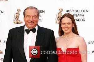 Dick Wolf and guest Golden Nymph awards ceremony - arrivals during the 2008 Monte Carlo Television Festival held at Grimaldi...