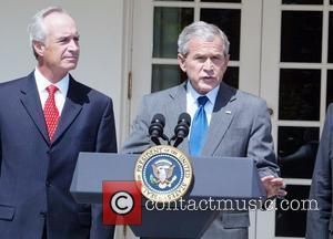 President George W. Bush addresses the nation during a press conference in the Rose Garden on reducing gas prices and...