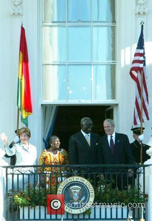 First Lady Laura Bush, Theresa Mensah, Pesident of Ghana John Kufuor and President George Bush participate in the South Lawn...