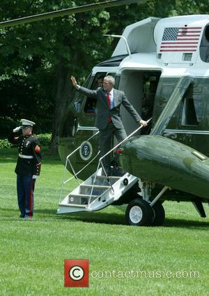 US President George W. Bush departed the Oval Office at the White House to board Marine One Washington DC, USA...