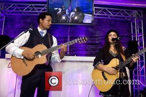 Terrence Howard and Ilsey Juber Perform at the Niche Media Michigan Avenue Launch Party hosted by Cindy Crawford at The...