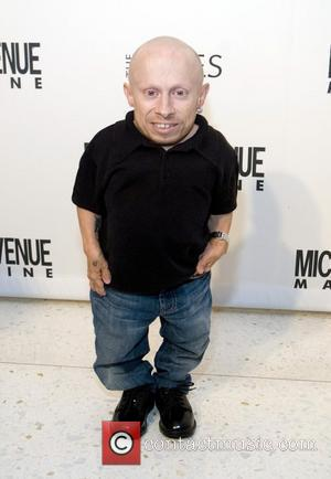 Verne Troyer and Cindy Crawford