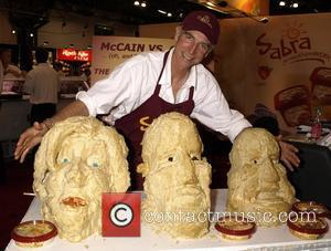 Hummus busts of Presidential candidates Hillary Clinton, Barack Obama and John McCain created by sand sculptor Kirk Rademaker on display...
