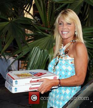 Pamela Bach leaving The Ivy restaurant. After having dinner with a male companion the actress buys Dominos pizza and hands...