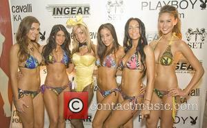 Playboy's Miss October 2005 Kimberly Holland and the 'Cyber Girls' models some of Playboys newest swim wear designs in association...