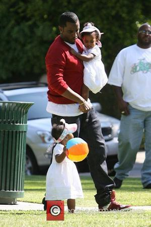 Sean 'P. Diddy' Combs  plays with his twin daughters D'Lila Star Combs and Jessie James Combs in Coldwater Park...