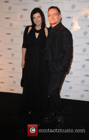 Bono, his wife Ali Hewson and Hampton Court Palace