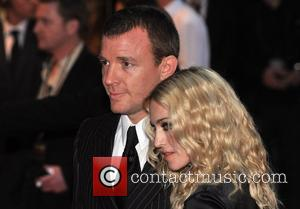 Madonna Keeps Ritchie Waiting At Film Premiere