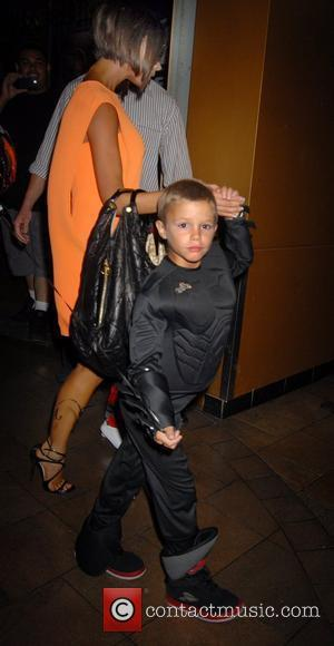 Victoria Beckham and Romeo Beckham at his 6th birthday party at the Hard Rock Cafe in Universal City