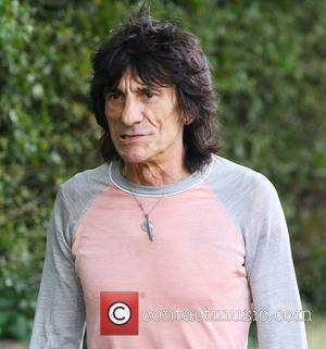 Ronnie Wood from The Rolling Stones takes a break during a rehab session at the Life Works Community Centre in...