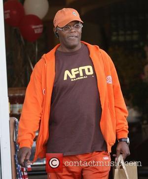 Samuel L Jackson, dressed head to toe in orange sportswear, just like a Doritos crisp, heads back to his Mercedes...