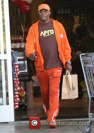 Samuel L Jackson, Dressed Head To Toe In Orange Sportswear, Just Like A Doritos Crisp and Heads Back To His Mercedes Car After Shopping For Groceries