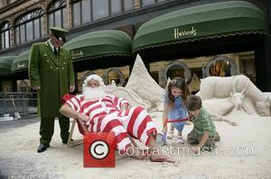 Father Christmas unveils an 8 tonne sand sculpture of a traditional Christmas scene by Andrew Baynes at the opening of...