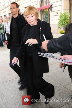 Shirley MacLaine  leaving Adlon Hotel on her way to Kulturkaufhaus Dussmann where she will promote her new book. She...