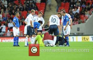 Injured referee Pierluigi Colina