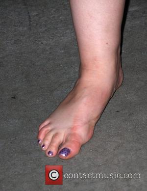 Yeardley Smith  shows photographers her feet after a long night of wearing heels while leaving the Comedy Central Emmy...