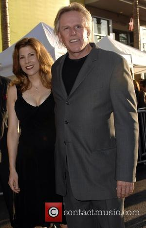 Gary Busey and Guest World premiere of 'Swing Vote' held at the El Capitan Theater - Arrivals Hollywood, California -...