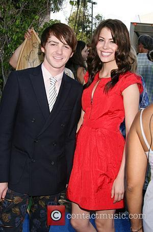 Drake Bell and Guest  Teen Choice Awards 2008 at the Universal Ampitheater at Universal Studios- Arrivals Los Angeles, California...