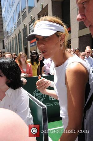 Monica Seles Monica Seles and Jim Courier compete on a pop up tennis court on Fifth Avenue to celebrate the...