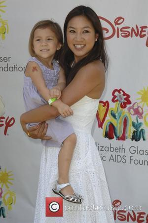Michelle Kwan,  Time for Heroes celebrity carnival to benefit The Elizabeth Glaser Pediatic Aids Foundation.  Los Angeles, California...