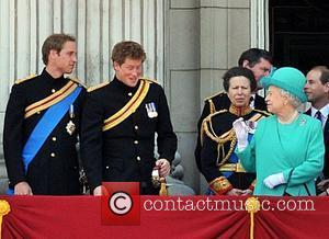Prince Harry  sneezes aloud which captures the attention of the Queen on the balcony of Buckingham Palace after the...