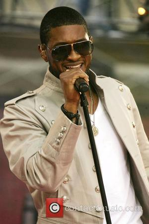 Usher's Wife Takes Aim At Critics