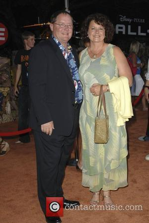 John Lasseter and Guest World premiere of Disney Pixar's ' Wall-E' at The Greek Theatre Los Angeles, California - 21.06.08