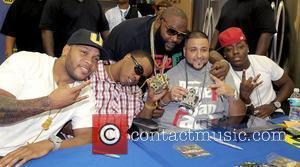 FLo Rida, Brisco, Rick Ross, DJ Khaled and Ace Hood  DJ Khaled signs copies of his new CD 'We...