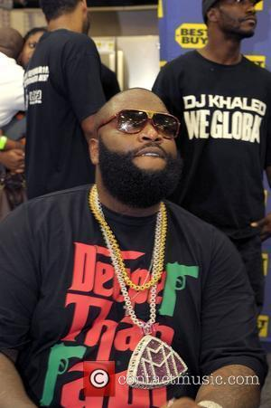 Rick Ross  DJ Khaled signs copies of his new CD 'We Global' at BestBuy Pembroke Pines, Florida - 16.09.08