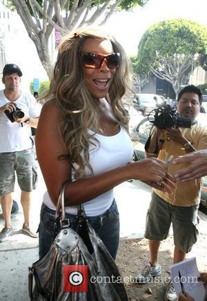Wendy Williams walking down Robertson Blvd with a plaster on her left knee, on her way to Kitson after having...