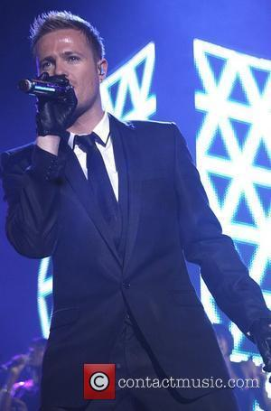 Nicki Bryne of Westlife performs live at Manchester Arena on Wednesday 04 June 2008