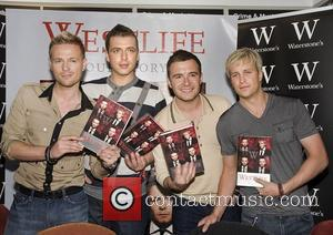 Mark Feehily and Shane Filan, Nicky Byrne, Kian Egan Westlife sign copies of their new autobiography 'Westlife - Our Story'...