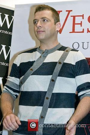Mark Feehily Westlife sign copies of their new autobiography 'Westlife - Our Story' at Waterstone's Liverpool, England - 18.06.08