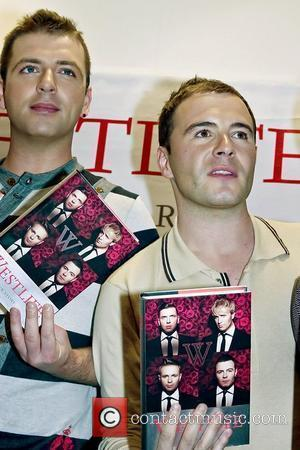 Mark Feehily and Shane Filan Westlife sign copies of their new autobiography 'Westlife - Our Story' at Waterstone's Liverpool, England...