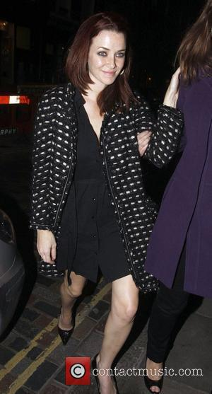 Annie Wersching returns to her hotel at 2.30am looking rather worse for wear after a night out in London with...