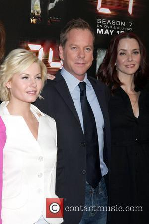 Elisha Cuthbert and Kiefer Sutherland