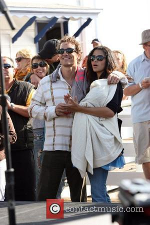 Matthew McConaughey, his girlfriend Camila Alves and their son Levi at the Surfrider Art and Music Festival on Malibu Pier....