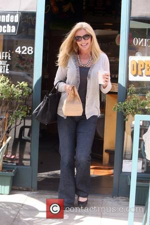 Shannon Tweed buys a coffee and a snack at a cafe. Beverly Hills, California - 29.04.09