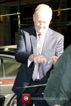 Bill O'Reilly host of the 'The O'Reilly Factor' gets upset after he gave his signature to a fan outside ABC's...