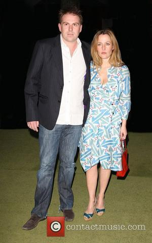 Gillian Anderson and Mark Griffiths 'The Age of Stupid' UK film premiere held at Leicester Square gardens in a solar...