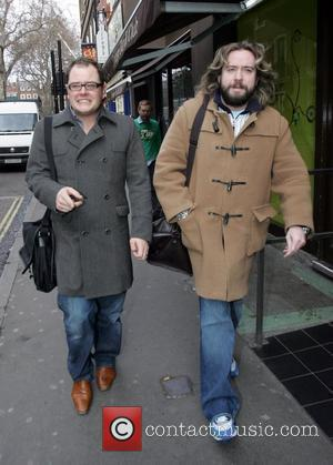 Justin Lee Collins and Alan Carr walking through Soho London, England - 30.01.09