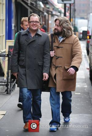 Alan Carr and Justin Lee Collins walking through Soho London, England - 30.01.09