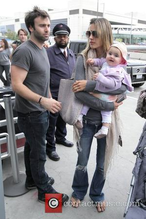 Alessandra Ambrosio and Jamie Mazur Arrive At Lax Airport With Daughter Anja Louise To Catch An American Airlines Flight