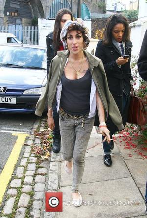Amy Winehouse looking happy as she goes for a drink in a local pub with friends. London, England - 11.11.08