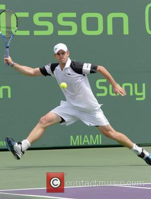 Andy Roddick plays against Dmitry Tursunov during day 7 of the Sony Ericsson Open at the Crandon Park Tennis Centre...