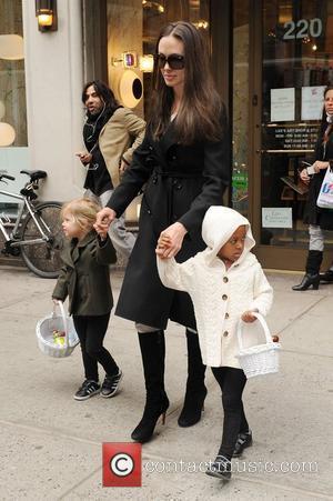 Angelina Jolie, Zahara Jolie-pitt and Shiloh Jolie-pitt Pick Up Art Supplies At Lee's Art Shop In Midtown Manhattan